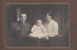 Sgt Lachlan GREY 41153 with his wife and child