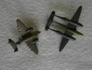 Two brooches made of brass.  Aeroplane on the left could be a Lockheed Ventura/Harpoon.  It measures 3.5cm length and 4.5cm width.  The aeroplane on the right is a Vampire.  It measures 4.5cm length and 5.5cm width.