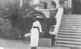 A waiter at the entrance to Maadi Club
