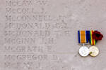In honour of Thomas Flavell McDonald, remembered on the wall of the Caterpillar Valley New Zealand Memorial, Somme, France. Photograph taken in June 2017.