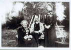 Group, Left to right Elizabeth (Lizzie) Browning Noake and Maillard Noake both seated in the garden, third person standing unknown - No known copyright restrictions