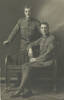 Brothers: Frederick Horace Dolphin, No.3/2055, 2nd NZ Field Ambulance, New Zealand Medical Corps (standing) with his older brother, George Alexander Dolphin No.3/2054, 2nd NZ Field Ambulance, New Zealand Medical Corps c1916 - No known copyright restrictions
