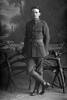 Full length portrait of T H Hawkins in uniform (Photographer: Herman Schmidt, 1916). Sir George Grey Special Collections, Auckland Libraries, 31-H573. No known copyright.