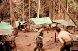 "10 Pl ""D"" Coy. first camp after surrender of Kerinching, Senogit, Regek. Feb 1960. Bill Brown running up the hill. Image taken during Malayan Emergency 1959-1960. © Peter Gallacher."