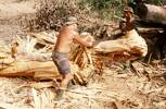 E. J. G. Ormsby and Bill Brown cutting tree trunk. Image taken during Malayan Emergency 1959-1960. © Peter Gallacher.