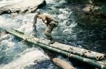 Pte Peter Gallagher on bamboo bridge. Image taken during Malayan Emergency 1959-1960. © Peter Gallacher.